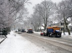 Clearing snow and salting the road